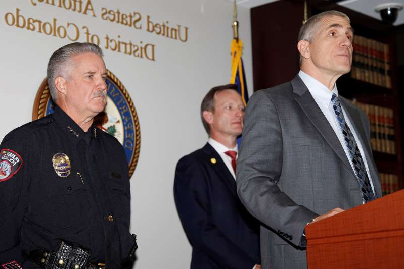 Dean Phillips, FBI special agent in charge, left, makes a point as Jason R. Dunn, U.S. Attorney for the District of Colorado, back left, and Chief Troy Davenport of the Pueblo, Colo., Police Department, look on during a news conference in Denver Monday, Nov. 4, 2019, to annouce the arrest of a man who repeatedly espoused anti-Semitic views in a plot to bomb a historic Colorado synagogue in Pueblo. Richard Holzer, 27, of Pueblo, was charged with a federal hate crime for plotting to blow up the Temple Emmanuel Synagogue in the southern Colorado city.(AP Photo/David Zalubowski)