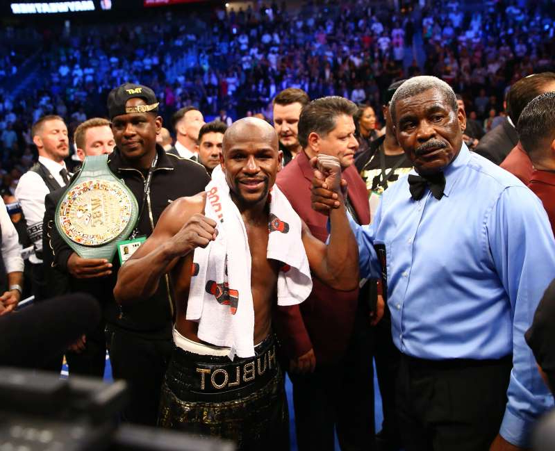 Floyd Mayweather Jr. et al. standing in front of a crowd posing for the camera: Floyd Mayweather says he's coming out of retirement -- again.
