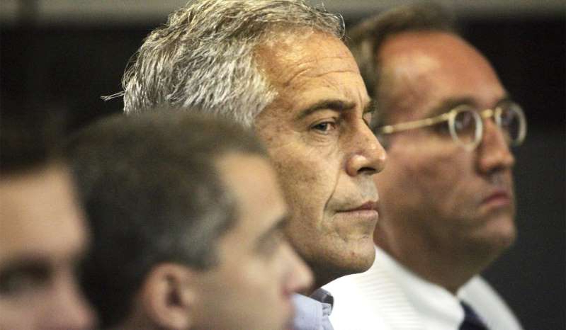 Jeffrey Epstein wearing glasses: Jeffrey Epstein (center) appears in court in West Palm Beach, Fla., July 30, 2008.