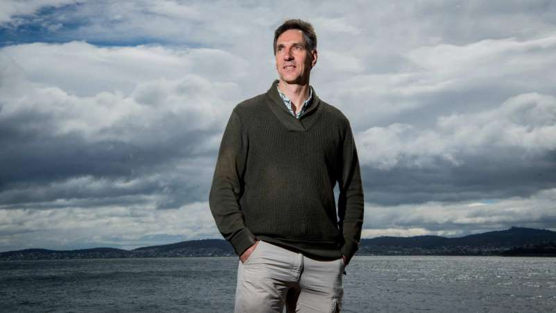 a man standing next to a body of water: The CSIRO's Alistair Hobday says the ocean is ringing