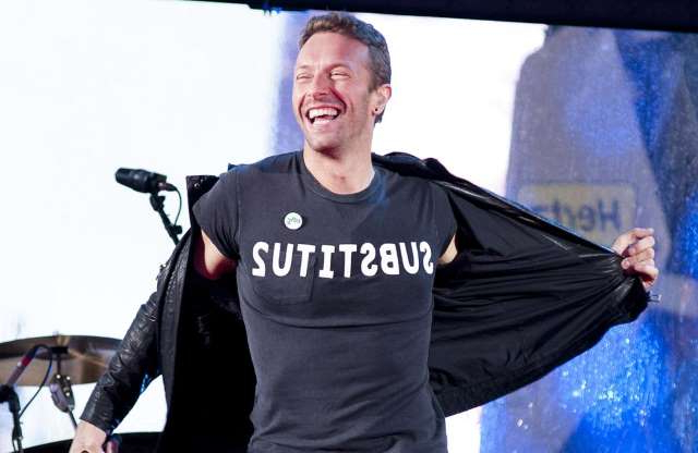 Chris Martin smiling for the camera