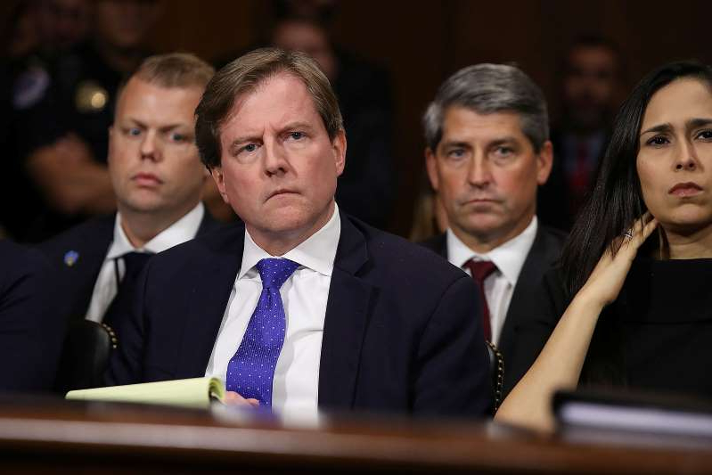 Don McGahn et al. posing for the camera: White House Counsel Don McGahn listens to Judge Brett Kavanaugh as he testifies before the Senate Judiciary Committee during his Supreme Court confirmation hearing in the Dirksen Senate Office Building on Capitol Hill in Washington