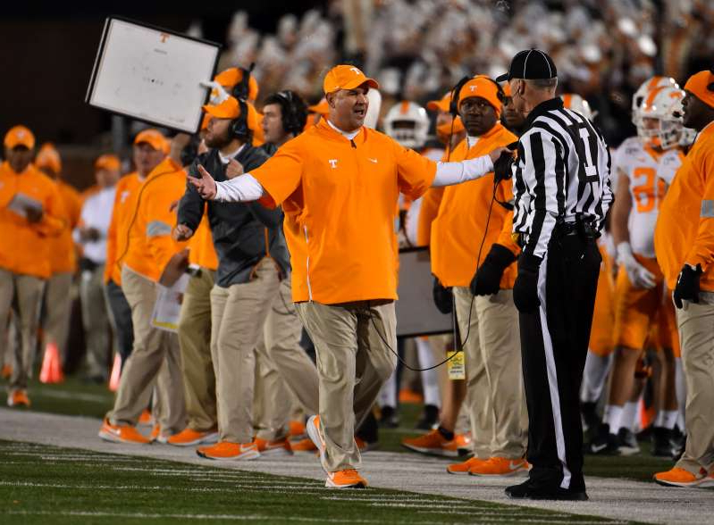 Jeremy Pruitt et al. wearing orange: Tennessee is now 6-5 after being 2-5. (Photo by Ed Zurga/Getty Images)
