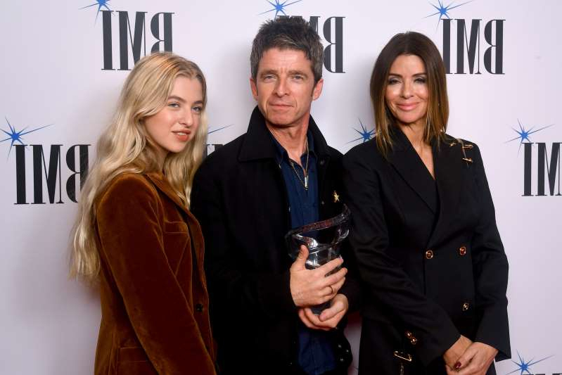 Noel Gallagher poses with the BMI President Award with wife Sara MacDonald and daughter Anais Gallagher during the 2019 BMI London Awards at The Savoy Hotel on October 21, 2019 in London, England. (Photo by Dave J Hogan/Getty Images for BMI London Awards)