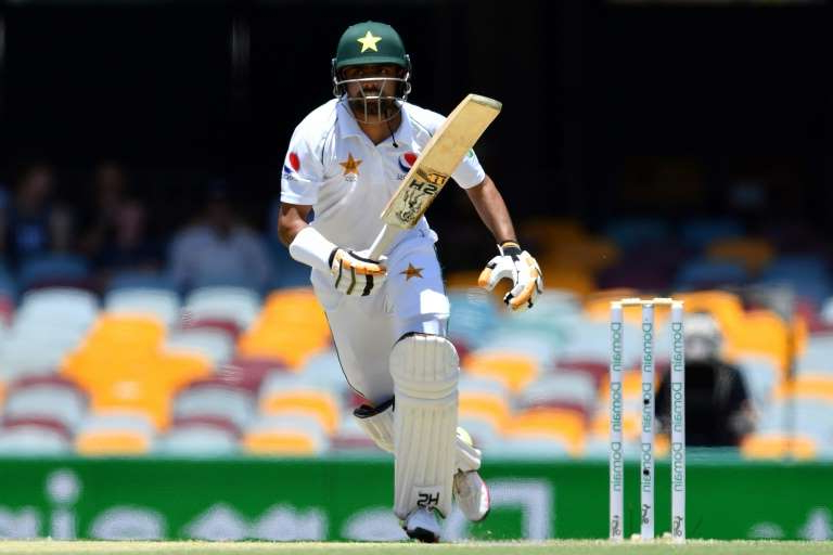 Pakistan's Babar Azam takes a run on his way to fifty on the fourth morning at the Gabba