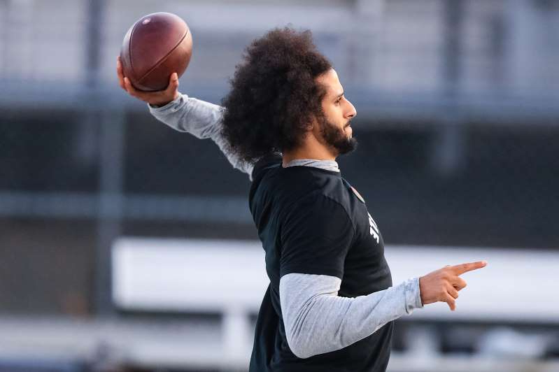 RIVERDALE, GA - NOVEMBER 16: Colin Kaepernick looks to make a pass during a private NFL workout held at Charles R Drew high school on November 16, 2019 in Riverdale, Georgia. Due to disagreements between Kaepernick and the NFL the location of the workout was abruptly changed.  (Photo by Carmen Mandato/Getty Images)