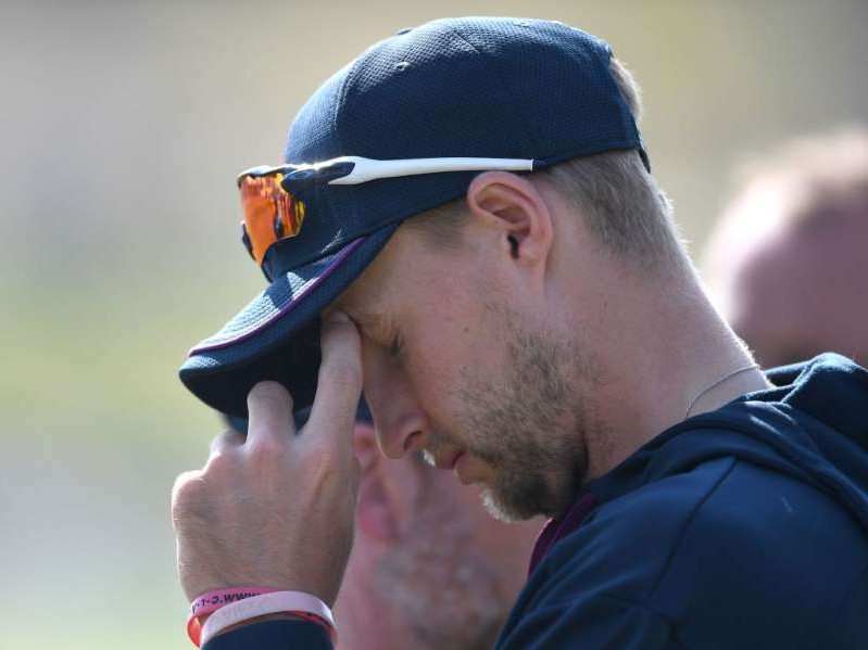 a man wearing a hat: England captain Joe Root contemplates his side's heavy defeat in the first Test against New Zealand
