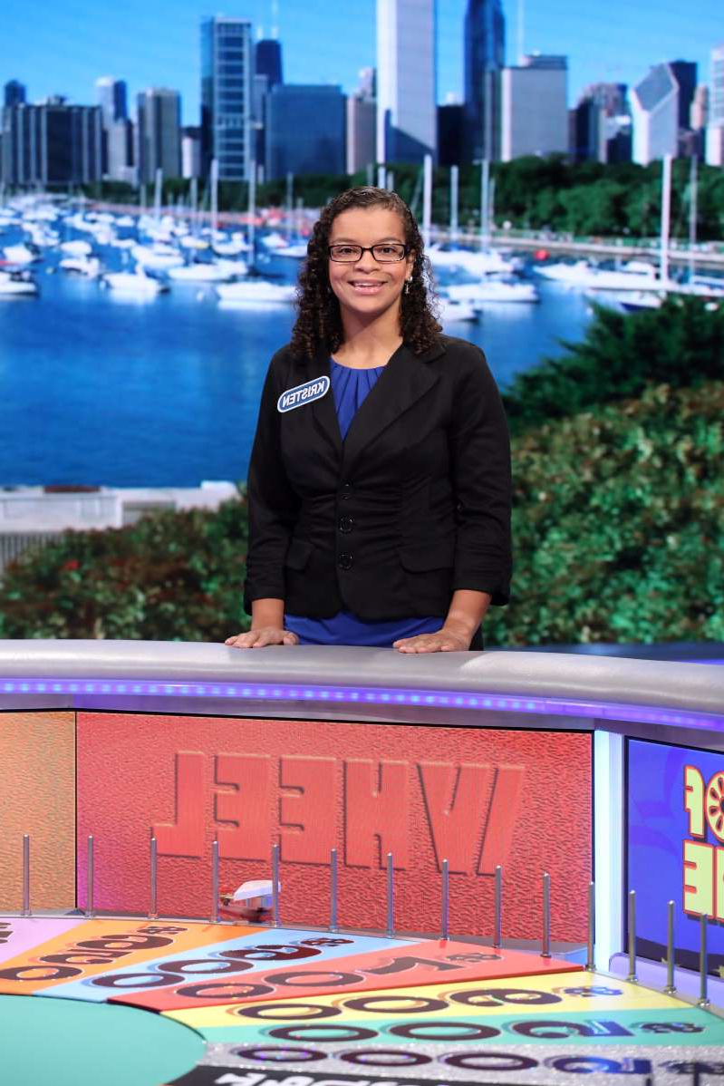 a person posing for the camera: Kristen Shaw, a Wheel of Fortune contestant who missed out on a trip to Nashville due to a technicality, has been given a new travel package by local hospitality companies.