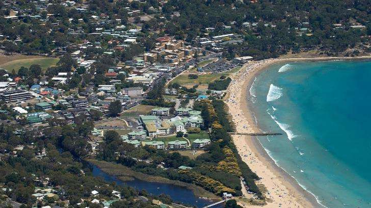 a view of a city by the water: A man has been arrested after police intercepted a car allegedly loaded with drugs headed for schoolies in Lorne.