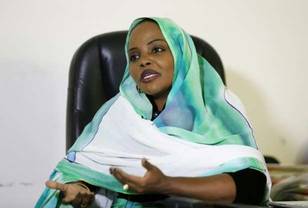 a woman sitting on a bed: Suleima Sharif, who heads a government committee combatting violence against women, says systemic such violence  -- including by law enforcers -- constrains female participation in politics