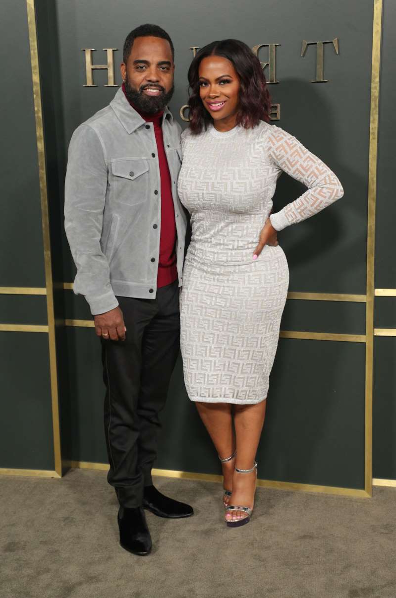 Kandi Burruss standing posing for the camera: Kandi Burruss and Todd Tucker attend the