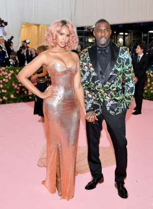 Slide 101 of 132: Just days after their wedding in Morocco, Idris Elba held hands with new wife Sabrina Dhowre on the red carpet at the 2019 Met Gala on May 6.