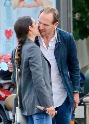 Slide 102 of 132: Ralph Fiennes was snapped kissing a mystery woman while out in Turin, Italy, on May 4.
