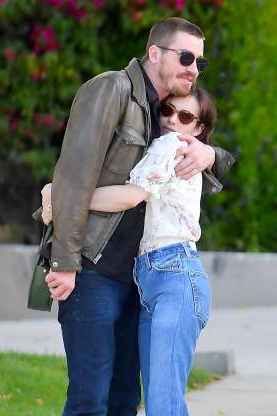 Slide 104 of 132: Garrett Hedlund and new girlfriend Emma Roberts shared a hug while out in Los Angeles on April 9.