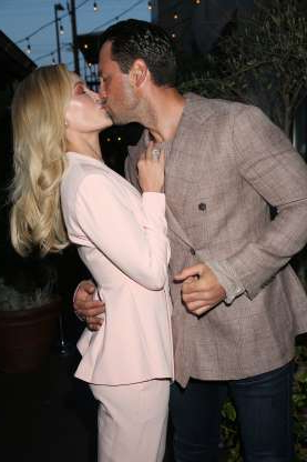 Slide 108 of 132: Maksim Chmerkovskiy and Peta Murgatroyd kissed at the LaPalme magazine spring issue release party in Los Angeles on April 16.