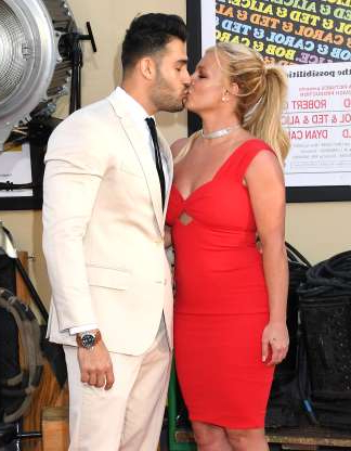 Slide 12 of 132: Britney Spears and boyfriend Sam Asghari kissed on the red carpet at the premiere of