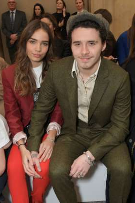 Slide 128 of 132: Brooklyn Beckham and then-girlfriend Hana Cross cuddled up during the Victoria Beckham show during London Fashion Week at the Tate in London on Feb. 17.