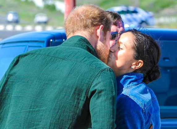 Slide 13 of 132: Prince Harry and Duchess Meghan shared a kiss during a visit to Waves for Change on Monwabisi Beach in Cape Town, South Africa, during day two of their royal tour of Southern Africa on Sept. 24, 2019.