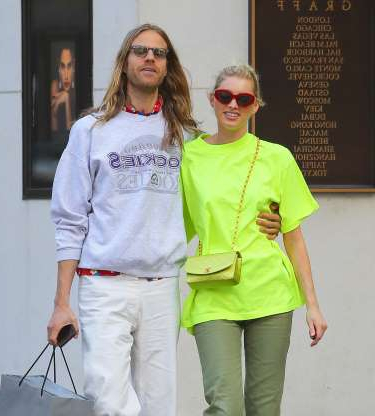 Slide 130 of 132: Model Elsa Hosk and love Tom Daly wrapped their arms around each other while shopping in New York City on June 7.