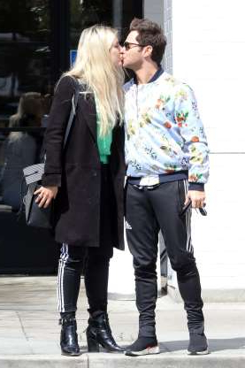 Slide 131 of 132: Married dancers Sasha Farber and Emma Slater shared a sweet kiss while heading to lunch in West Hollywood on March 9.