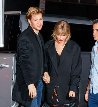 Slide 17 of 132: Taylor Swift and Joe Alwyn held hands as they arrived at Zuma in New York City on Oct. 6 after she performed on