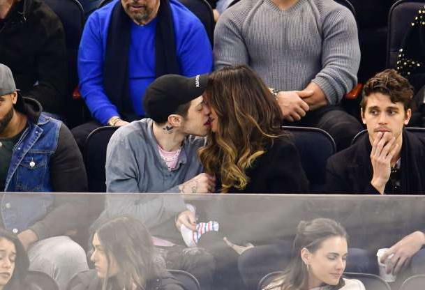 Slide 19 of 132: Kate Beckinsale and Pete Davidson kissed during a New York Rangers hockey game at Madison Square Garden on March 3.