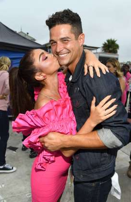 Slide 21 of 132: Wells Adams got a kiss from fiancée Sarah Hyland at FOX's Teen Choice Awards in Hermosa Beach, California, on Aug. 11.