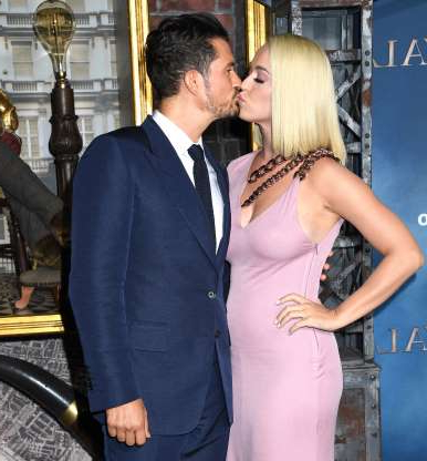 Slide 26 of 132: Katy Perry and fiancé Orlando Bloom shared a kiss on the red carpet at the premiere of his new show, Amazon's