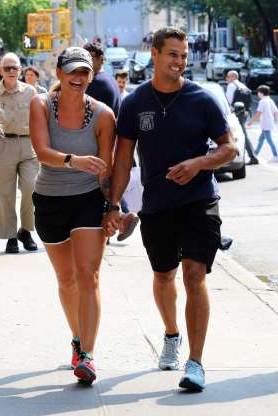 Slide 28 of 132: Newlyweds Brendan McLoughlin and Miranda Lambert were all smiles as they held hands in New York City on July 8.