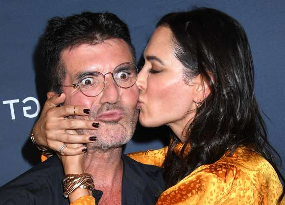 Slide 30 of 132: Lauren Silverman kissed boyfriend Simon Cowell on the cheek on the red carpet at the