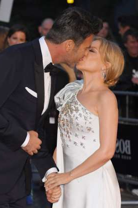 Slide 31 of 132: Kylie Minogue kissed boyfriend Paul Solomons at the GQ Men of the Year Awards at the Tate Modern in London on Sept. 3.