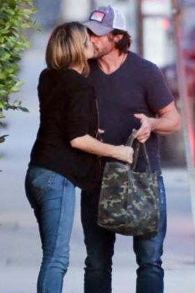 Slide 4 of 132: Denise Richards and husband Aaron Phypers shared a kiss as they arrived to have dinner in Santa Monica, California, on Nov. 2.