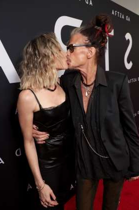 Slide 40 of 132: Aerosmith frontman Steven Tyler and girlfriend Aimee Preston kissed on the red carpet at a special screening of