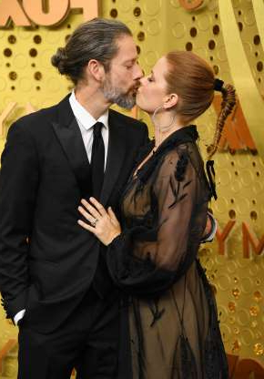 Slide 43 of 132: Amy Adams kissed husband Darren Le Gallo at the Emmy Awards at the Microsoft Theater in Los Angeles on Sept. 22.