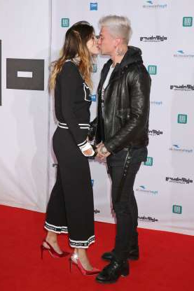 Slide 45 of 132: Benjamin Mascolo kissed girlfriend Bella Thorne at the