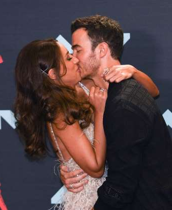 Slide 48 of 132: Kevin Jonas kissed wife Danielle at the MTV Video Music Awards at the Prudential Center in Newark, New Jersey, on Aug. 26.