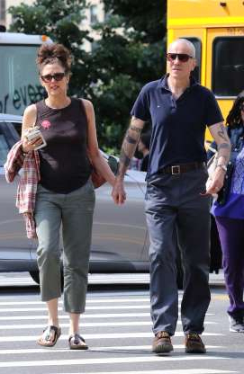 Slide 69 of 132: Daniel Day-Lewis and wife Rebecca Miller held hands while enjoying a summer stroll in New York City on July 12.