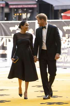 Slide 76 of 132: Prince Harry and Duchess Meghan looked like a million bucks as they arrived hand in hand for the premiere of