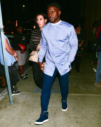 Slide 79 of 132: Former NFL star Reggie Bush held hands with wife Lilit Avagyan while heading to dinner in Los Angeles on Oct. 4.