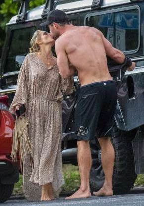 Slide 9 of 132: Chris Hemsworth and wife Elsa Pataky shared a kiss after a day at the beach in Byron Bay, Australia, on May 9.