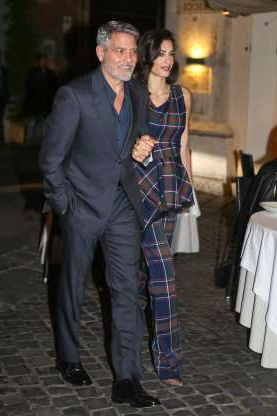 Slide 91 of 132: George Clooney held hands with wife Amal Clooney as they stepped out for dinner at Da Pierluigi in Rome on May 12.