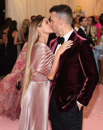 Slide 93 of 132: Gisele Bundchen and husband Tom Brady shared a kiss on the red carpet at the 2019 Met Gala on May 6.