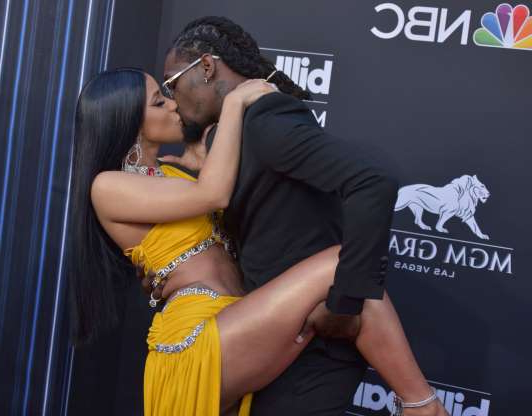 Slide 94 of 132: Comin' in hot! Cardi B got a big kiss from husband Offset as they arrived at the 2019 Billboard Music Awards in Las Vegas on May 1.