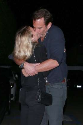 Slide 96 of 132: Will Arnett and Alessandra Brawn kissed while leaving dinner in Los Angeles on March 29.
