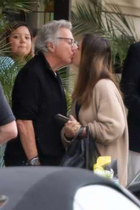Slide 98 of 132: Screen legend Dustin Hoffman and wife Lisa shared a sweet kiss while leaving their hotel in Casa Del Mar, California, on May 9.