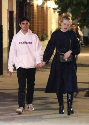 Slide 99 of 132: Elle Fanning and boyfriend Max Minghella held hands while leaving dinner in New York City on May 4.