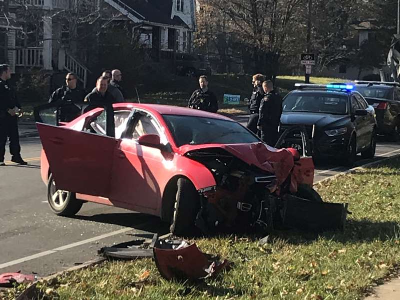 a car parked on the side of a road: A suspected bank robber crashed his car in Cleveland.