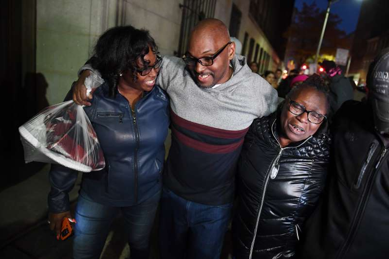 BALTIMORE, MD - NOVEMBER 25: Mary Stewart, left, walks with her son, Andrew Stewart and her daughter, Ulonda Stewart, Andrew's sister after he along with Alfred Chestnut and Ransom Watkins were released and exonerated for the 1983 murder they were convicted of on Monday November 25, 2019 in Baltimore, MD. The three were given life sentences for the murder of DeWitt Duckett.