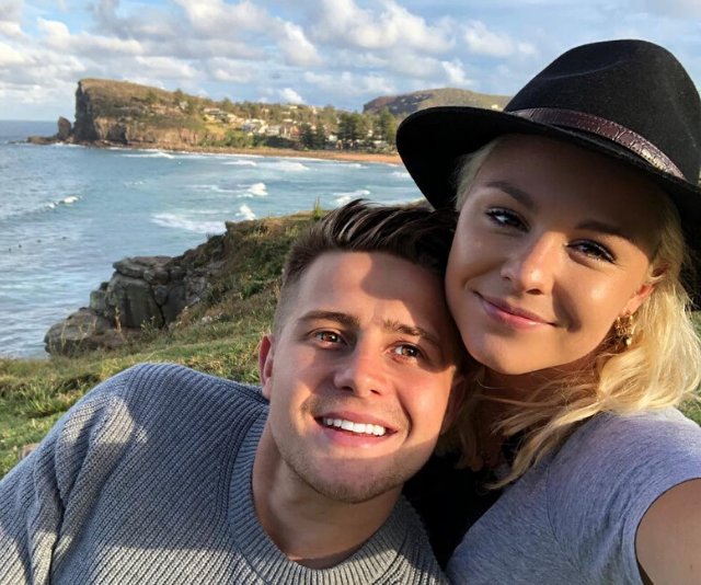 a close up of a girl smiling next to a body of water: Married At First Sight 2020 groom Mikey Pembroke's ex-girlfriend is the gorgeous fitness influencer Katie Williams, a former professional athlete who also appeared on Ninja Warrior Australia