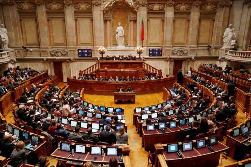a group of people in a room: FILE PHOTO: A view of the Portuguese Parliament hall during a debate on 2019 state budget in Lisbon